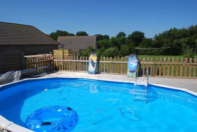 Solar heated enclosed swimming pool